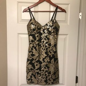 Black and gold sequenced mini dress